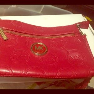 Red Micheal Kors purse